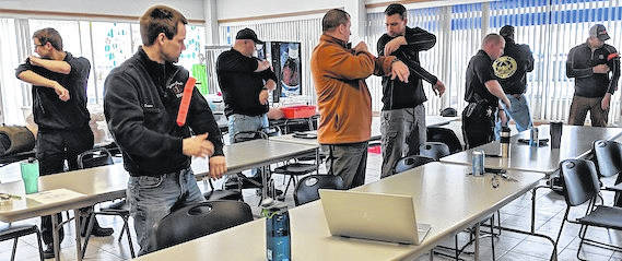 EMS personnel practice with tourniquets at the Tactical Emergency Casualty Care Course. Law enforcement officers were also included in the course.