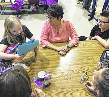 Third, fourth and fifth graders at Highland Elementary School participated in a Mix It Up Day during lunch on March 23. Students were directed to a specific table, with others they normally don't sit with at lunch. This was an opportunity for us to make new friends and sit with someone different. Although this lunch activity was only for students in grades 3-5, the entire school was encouraged to reach out to someone they didn't know.