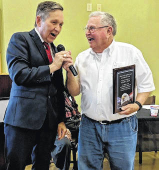 Candidate for Governor, Dennis Kucinich at left presenting Morrow County Democrat of the Year award to Dick Sears. Sears noted that both he and Kucinich were 27 years old when they ran for office the first time.