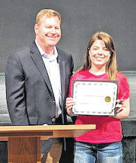 Consolidated Electric Cooperative's Brian Ebersole presents the Morrow County Chamber of Commerce Student of the month award to Samantha Landon of The Tomorrow Center.