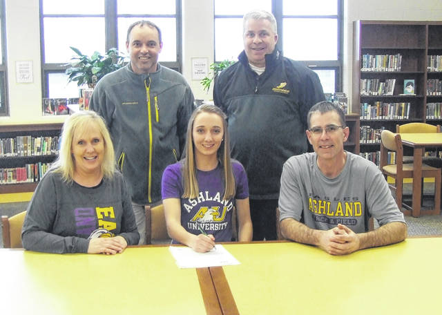 Northmor senior Hope Miracle signs to compete in track and field for Ashland University. In the front row with Miracle are her parents, Lisa and Todd. In the back row are Northmor track coaches Kevin Ruhl (l) and Mark Yaussy.