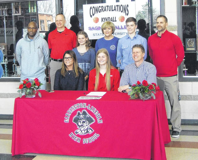 Cardington senior Kyndall Spires (front row, center) is pictured with her family and coaches as she signed to play basketball for Saginaw Valley State University. In the front row with Spires are her parents, Crystal and Dan. In the back row are (l-r): AAU coach Willie Jordan, Cardington assistant coach Scott Hardwick, Alexis Miller-Spires, grandmother Deborah Wells, Cayman Spires and Cardington head coach Jamie Edwards.