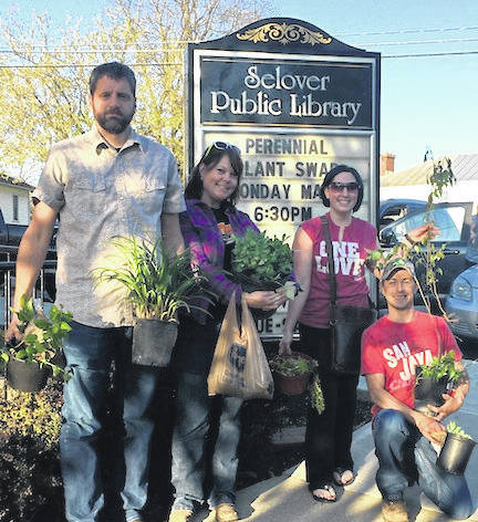 Rick and Tammy Tiedtke and Kate and Curtis Mirise attended Selover Library's Perennial Plant Swap and went home with some new additions for their gardens.