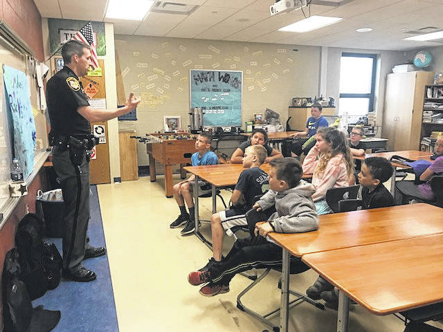 Deputy Lance Plough with the Morrow County Sheriff's Office spoke at Highland Elementary School's career day.