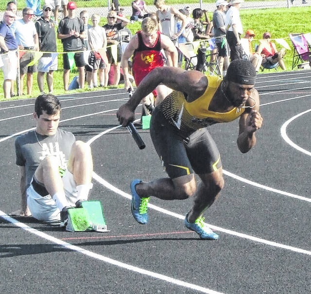 Demetrius Johnson of Northmor charges out of the blocks to start the 800-meter relay. The Knights advanced to state in that event by placing first.