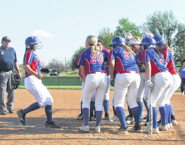 Morgan Wilhelm's (left) Highland teammates prepare to mob her as she rounds the bases after hitting a three-run home run in the decisive fourth inning of the team's 10-4 win over River Valley Thursday.