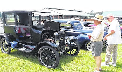 Mark Melroy, left, describes his 1924 Model T to a visitor to the 41st Rod 'N Tiques Car show held at the Morrow County Fairgrounds. Melroy, of Caledonia, said he has had the car for five years but it was purchased new and driven for many years by a school teacher.