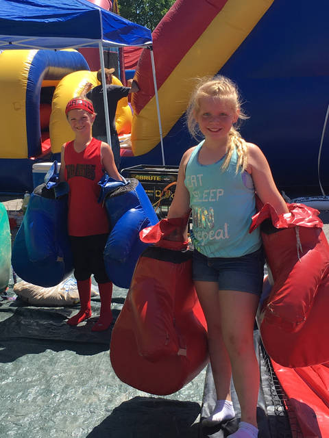 Children play on the inflatables during the Cardington Street Fair in 2016.