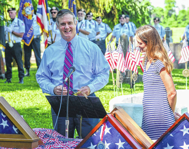 Retired Army Lt. Colonel John Chapman and his daughter, Jessica Chapman Southard, West Point graduate who served two tours of duty in Iraq, shown giving the Memorial Day address at Bryn Zion Cemetery.