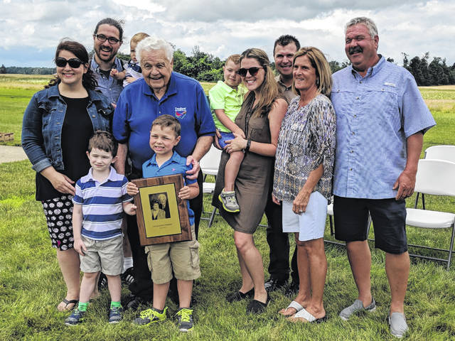 Jack Fishburn with several of his family members and the ODNR Hall of Fame award presented to him June 23.