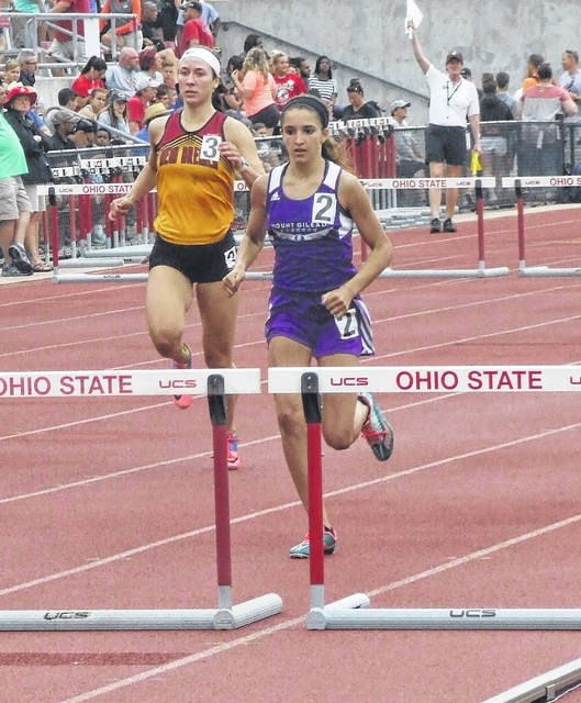 Allison Johnson approaches a hurdle in the 300-meter hurdles in the state meet. She would place fourth in that event, sixth in the 100 hurdles and third as the first leg of the 3200-meter relay team.