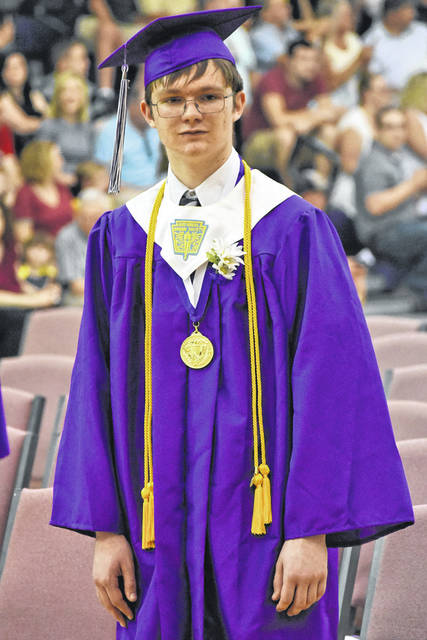 Valedictorian Casey Conrad is shown leading the processional at Mount Gilead High School's commencement.