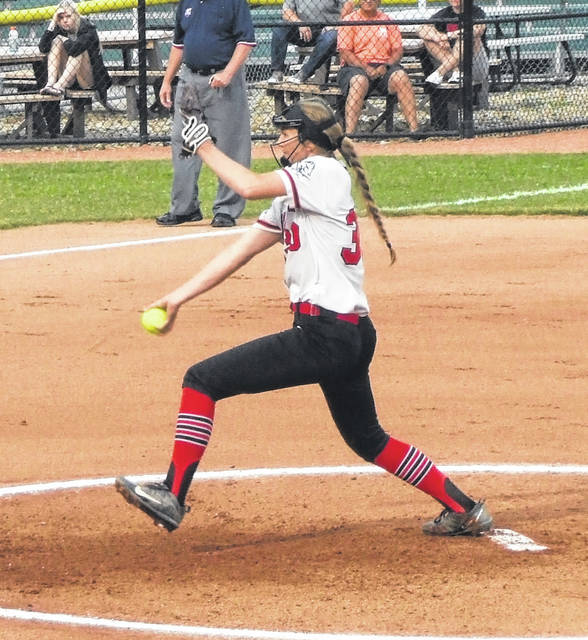 Casey Bertke prepares to unleash a pitch against Lore City Buckeye Trail on Friday. Bertke pitched a five-inning shutout in her team's 10-0 win.