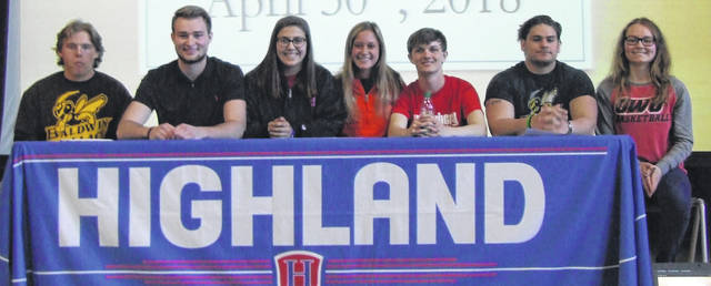 Seven Highland student-athletes announced their college signings this spring. From left to right are Matt Reid (football, Baldwin-Wallace); Kaleb Phillips (basketball, Wittenberg); Mckenzie Fuller (basketball, Muskingum), Sophia Thompson (track and cross country, Ohio Northern); Travis Mentzer (track, Wittenburg); Javier Vasquez (football, Baldwin-Wallace) and Erica Sardinha (basketball, Ohio Wesleyan).