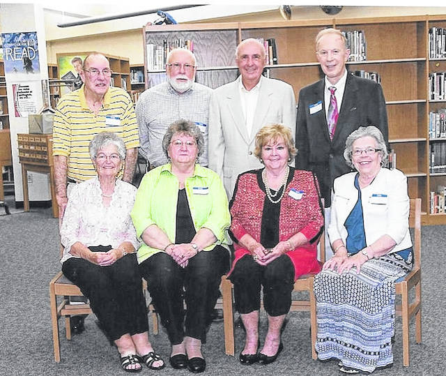These are members of the Cardington High School Class of 1956 who met at the Cardington-Lincoln High School alumni party. They met before the dinner. Back row, from left: Raymond Maple, Bill Phillips, Jon Yake, Dr. James Murphy DDS. Seated, Carol Harris Studer, Geraldine Fowble Osborne, Rodella Jenkins Covert and Sylvia Truax Hack.