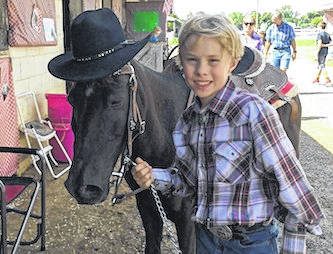 "Lane Hughes of Cardington among youth honored by Tractor Supply Company's ""Follow Us to the Fair"" Tour. He is one of several 4-H and FFA youth recognized for making a difference in their communities."