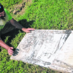 Repairing tombstones at Pagetown Cemetery — photos by Anthony Conchel