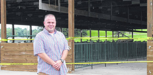 Brandon Strain, president of the Morrow County Fair Board, stands at the goat barn where a new concrete floor has been poured.