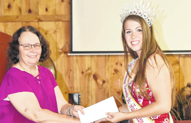 Morrow County Junior Fair coordinator Julie Logan presents the Morrow County Junior Fair award to Rebecca Duckworth.
