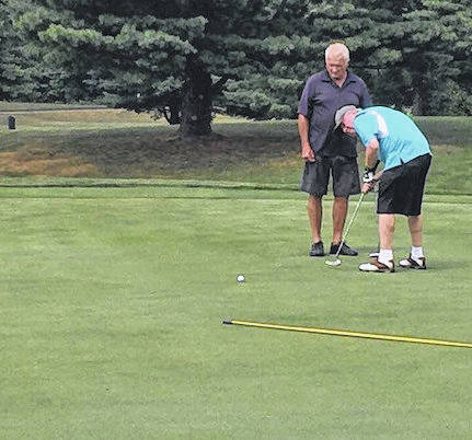 Rich Moffitt of Delaware sinks a putt on the first hole at Pine Lakes during the Kiwanis Club annual golf outing. Fifteen teams took part Aug. 15 in the scramble that is the club's largest fund-raiser.