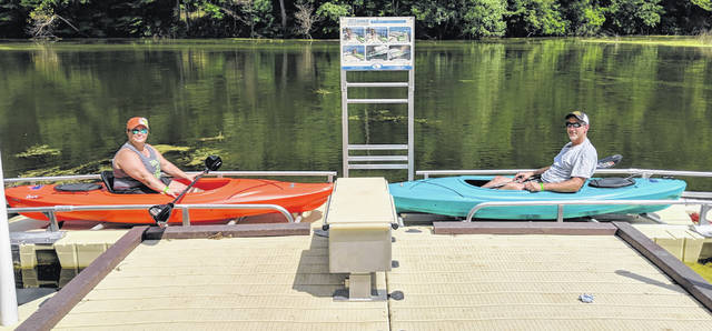 Kayakers Jen and Jamie Brasee of Wellington, Ohio appreciate the new boat ramp at the park.