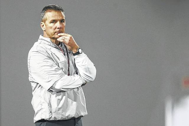 FILE - In this March 8, 2016, file photo, Ohio State coach Urban Meyer watches NCAA college football practice in Columbus, Ohio. Of all the holes hes got to fill in Ohio States starting lineup this fall, Meyer recently has talked about the offensive and defensive lines as being the most critical areas of concern. (AP Photo/Jay LaPrete, File)