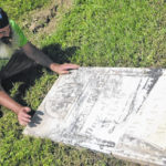 Repairing old tombstones at Pagetown Cemetery