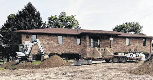 Hinkle Builders of Marengo are contracted to make improvements to the parking lot and front entrance and steps at Walnut Place.