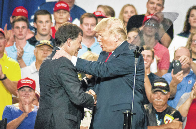 President Donald Trump made a personal appearance on Saturday in Delaware County to rally support for Ohio's 12th Congressional District Republican candidate Troy Balderson at Olentangy Orange High School in Lewis Center. Before turning over the podium to Balderson, the president exchanged a quick handshake and greeting with the candidate before a crowd of thousands.