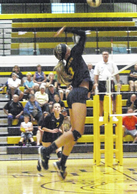 Northmor's Julianne Kincaid goes up for a kill attempt in Northmor's four-game win over Cardington Tuesday night.