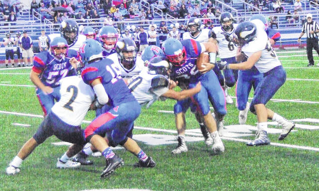 Highland's Tate Tobin battles through River Valley defenders for yards in his team's 41-8 win Friday night.